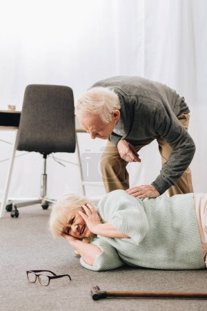 Photo for Old men helping wife who falled down on floor - Royalty Free Image