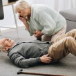 Senior woman looking at husband who falled down wi...