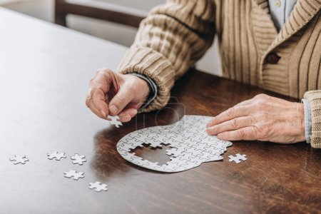 Photo for Cropped view of senior man playing with puzzles - Royalty Free Image