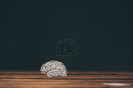 Photo for Paper with brain shape as dementia symbol on black background - Royalty Free Image