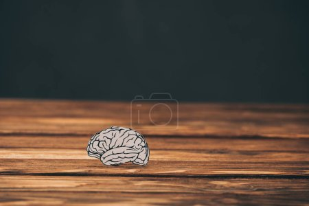 Photo for Paper with brain shape as alzheimer symbol on black background - Royalty Free Image