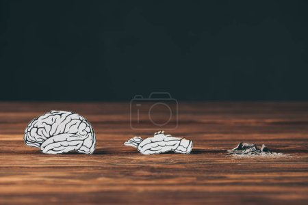 Photo for Papers with brain disease as dementia symbol on black background - Royalty Free Image