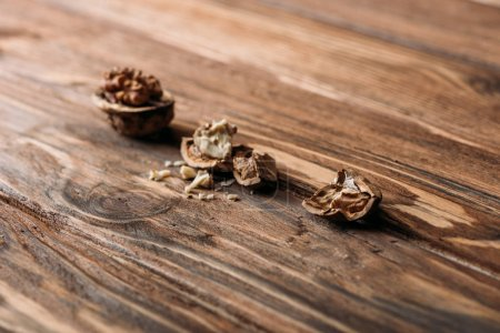 cracked walnuts in nut shells as dementia symbol on wooden table