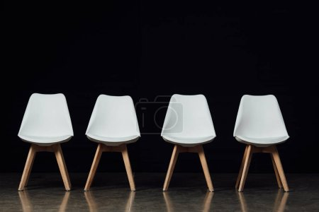 modern white chairs on isolated on black