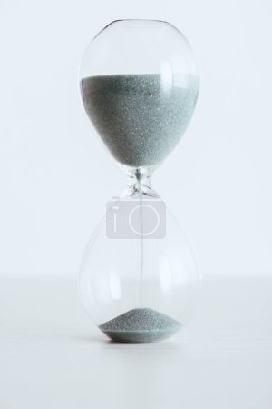 transparent hourglass with running sand isolated on white