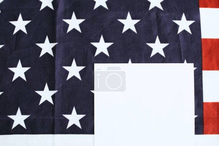 top view of paper on american flag with stras and stripes and paper with copy space