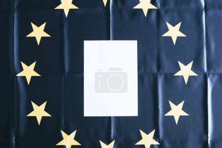 Photo for Top view of white blank with copy space with european flag on background - Royalty Free Image
