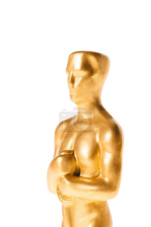 Photo for Close up of shiny oscar award isolated on white - Royalty Free Image
