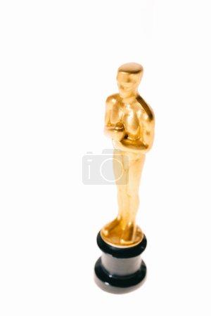 Photo for Shiny golden oscar trophy isolated on white - Royalty Free Image