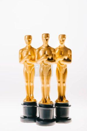 Photo for Row of golden oscar awards isolated on white - Royalty Free Image