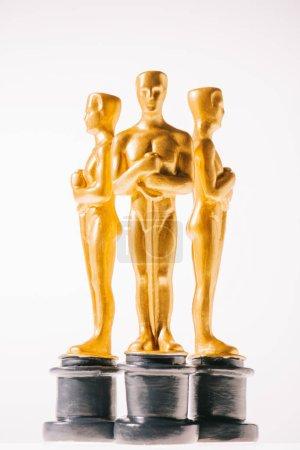 Photo for Hollywood oscar award statuettes isolated on white - Royalty Free Image
