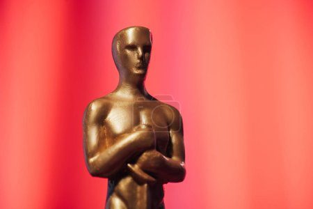Photo for Golden oscar award on red background with copy space - Royalty Free Image