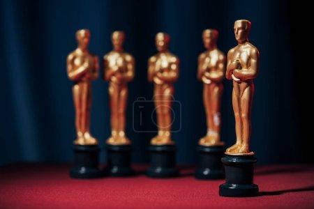 Photo for Row of hollywood golden oscar awards on dark background - Royalty Free Image