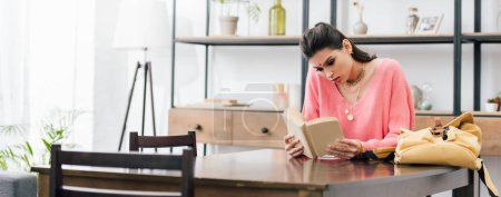 Photo for Indian woman with bindi studying at home with books - Royalty Free Image