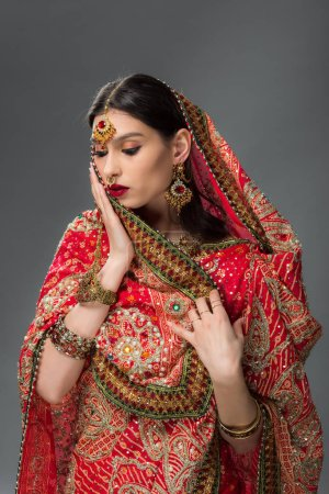 Photo for Elegant indian woman in traditional sari and bindi, isolated on grey - Royalty Free Image