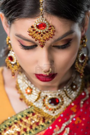 Photo for Beautiful indian girl posing in traditional bindi, isolated on grey - Royalty Free Image