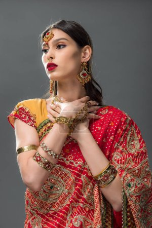 Photo for Beautiful indian woman in sari and accessories, isolated on grey - Royalty Free Image