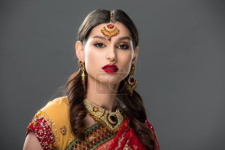 Photo for Elegant indian woman in sari and accessories, isolated on grey - Royalty Free Image