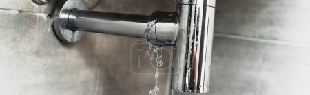 Photo for Damaged steel pipe with water drops on grey background - Royalty Free Image
