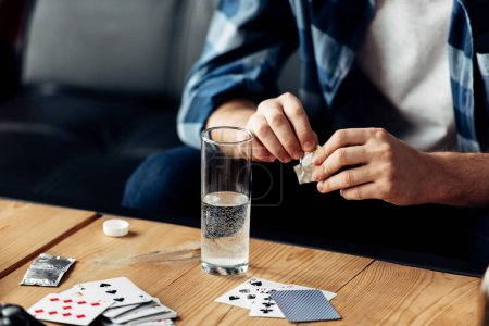 Photo for Cropped view of man holding aspirin near glass of water - Royalty Free Image