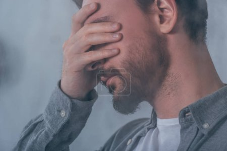 Photo for Adult man covering face with hands and crying - Royalty Free Image