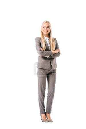 smiling attractive businesswoman posing with crossed arms isolated on white