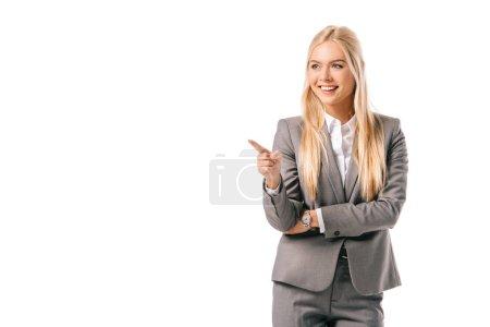 Photo pour Heureuse femme blonde présenter quelque chose isolé sur blanc - image libre de droit
