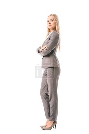 Photo for Beautiful confident businesswoman posing with crossed arms isolated on white - Royalty Free Image