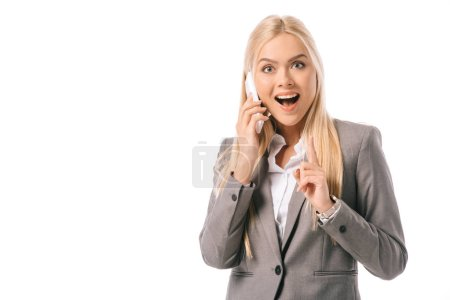 Photo for Excited businesswoman having idea and pointing up while talking on smartphone isolated on white - Royalty Free Image