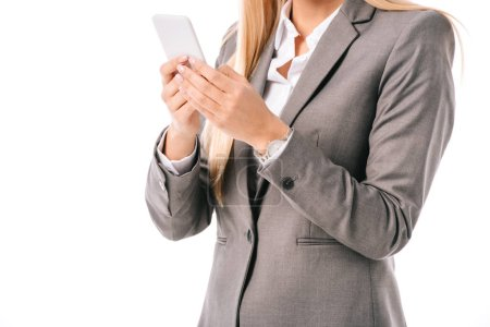 Photo for Cropped view of businesswoman using smartphone isolated on white - Royalty Free Image