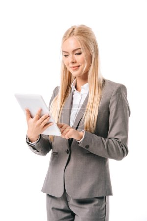 smiling businesswoman working on digital tablet isolated on white