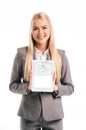 Photo for Smiling blonde businesswoman showing digital tablet with skype appliance on screen, isolated on white - Royalty Free Image
