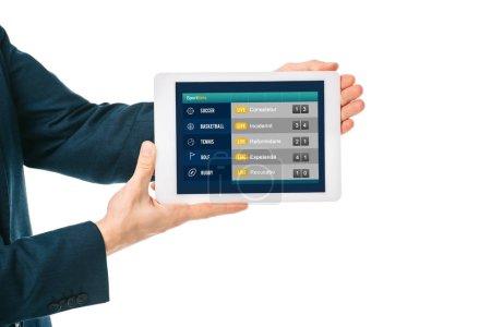 Photo pour Vue recadrée de l'homme d'affaires montrant tablette numérique avec application de sport, isolé sur blanc - image libre de droit