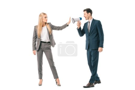 Photo for Male boss shouting into megaphone at businesswoman who showing stop gesture isolated on white, gender equality concept - Royalty Free Image