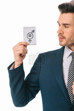 Photo pour Beau homme d'affaires regardant signe d'égalité des sexes, isolé sur blanc - image libre de droit