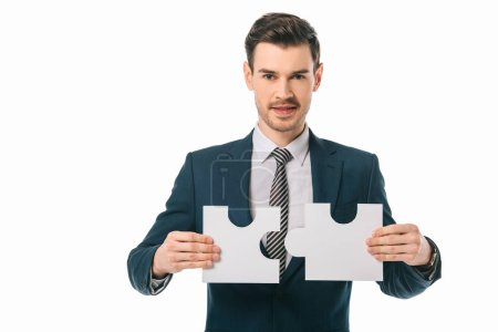 Photo for Handsome businessman holding puzzle pieces isolated on white, business idea concept - Royalty Free Image