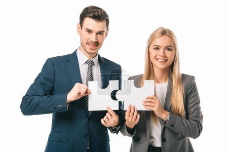 smiling businesspeople holding puzzle pieces isolated on white, business strategy concept