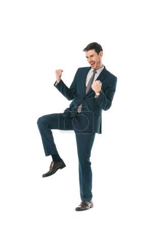 Photo pour Homme d'affaires réussi en costume célébrant triomphe isolé sur blanc - image libre de droit