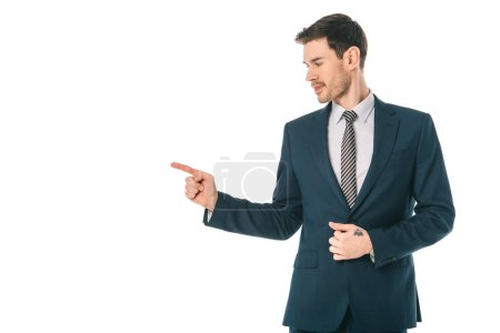 Photo for Handsome businessman pointing at something isolated on white - Royalty Free Image