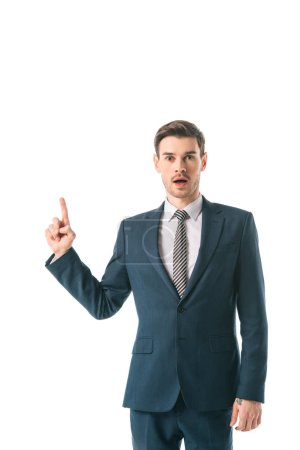 shocked businessman having idea and pointing up isolated on white