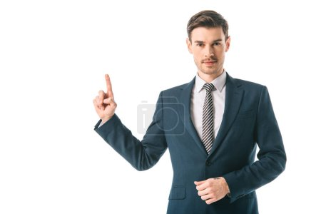 Photo for Handsome businessman in suit pointing up isolated on white - Royalty Free Image