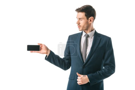 businessman presenting smartphone with blank screen, isolated on white