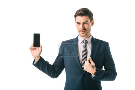 Photo for Confident businessman holding smartphone with blank screen, isolated on white - Royalty Free Image