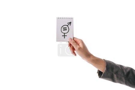 Photo pour Vue partielle de la femme tenant le symbole de l'égalité des sexes, isolé sur blanc - image libre de droit