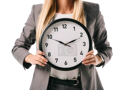 Photo for Cropped view of businesswoman holding clock isolated on white - Royalty Free Image