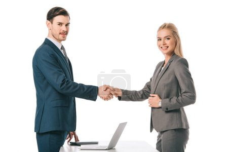Photo for Successful businesspeople shaking hands and having deal at workplace with laptop, isolated on white - Royalty Free Image