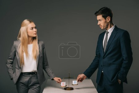 Photo for Business colleagues with male and female signs on scales of justice, gender equality concept - Royalty Free Image