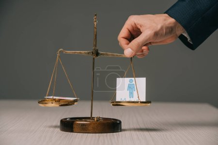 Photo for Cropped view of businessman with scales of justice and male signs, gender stereotypes concept - Royalty Free Image