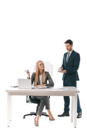 male secretary brought cup of coffee for successful businesswoman at workplace with laptop, isolated on white