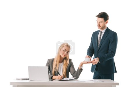 male secretary brought coffee for busy businesswoman at workplace with laptop, isolated on white